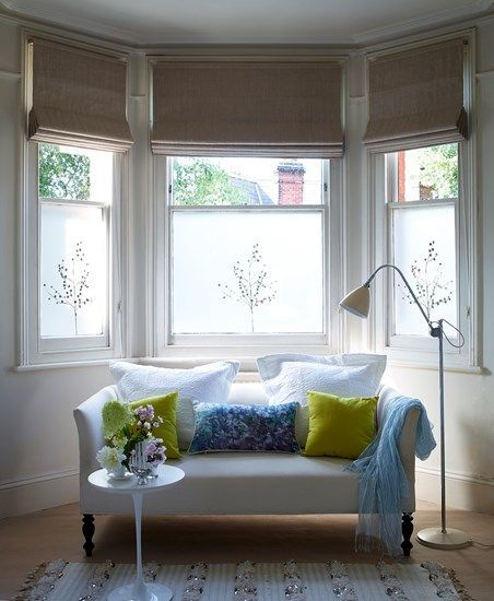 Bay window with blinds and window film